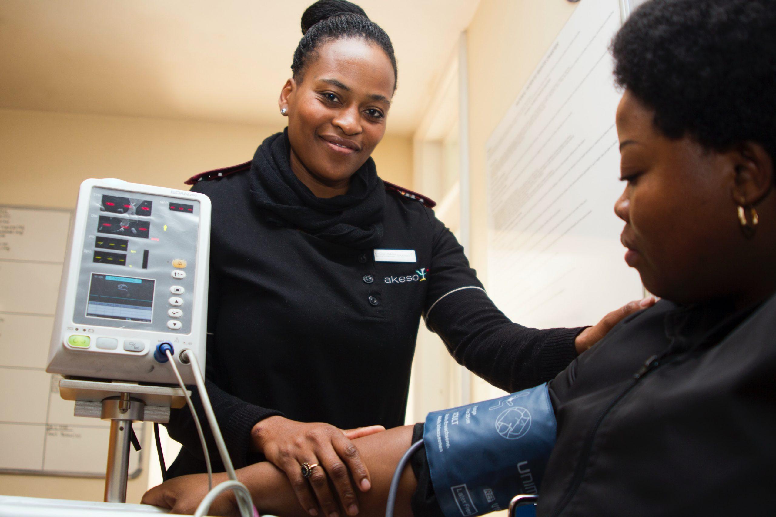 black nurse attends to patient
